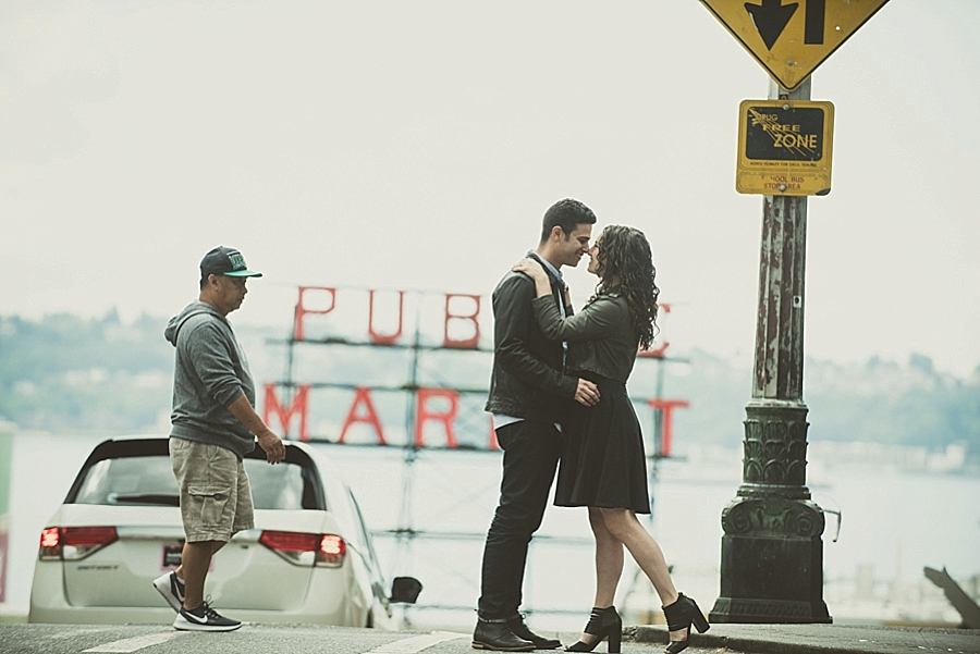 Engagement photo in front of the Pubic Market sigh