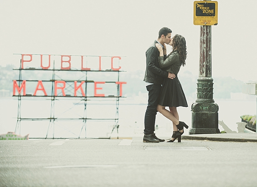 Engagement photo in front of the Public Market sign in Seattle